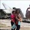 """Berfoto di Lokasi Jatuhnya Hercules, Dua Wanita Ini Dikecam """"Netizen"""""""